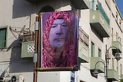 Sco0033837 .  Daily Telegraph..A satiric doctored photo of deposed leader Col Muammar Gadaffi hangs off a post in central Tripoli...Life returning to normality on the streets of Tripoli...Tripoli 30 August 2011. ............Not Getty.Not Reuters.Not AP.Not Reuters.Not PA....