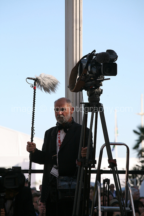 A cameraman holds sound microphone at the Cannes Film Festival in Cannes 2013