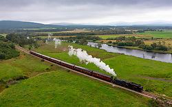 Broomhill, Scotland, UK. 26th August 2021.  Recently renovated steam locomotive Black 5025 pulls carriages of tourists on the Strathspey Railway between Broomhill and Aviemore. The railway is running an almost full schedule this summer despite Covid restrictions on passenger numbers.  Iain Masterton/Alamy Live News.