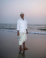 Cox's Bazar, Bangladesh - October 25, 2017: A man walks on the beach at sunset in Cox's Bazar.