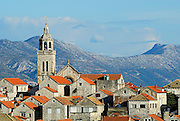 Detail of rooftops with Croatian mainland in background. Korcula old town, island of Korcula, Croatia