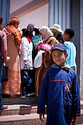Mahmoud in front of the entrance of his school is greeted by his aunt (also tutor) Sanae Oulkaid to grab lunch outdoors.