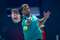 August 10, 2018 - Toronto, ON, U.S. - TORONTO, ON - AUGUST 10: Grigor Dimitrov (BUL) returns the ball during his Quarter-Finals match of the Rogers Cup tennis tournament on August 10, 2018, at Aviva Centre in Toronto, ON, Canada. (Photo by Julian Avram/Icon Sportswire) (Credit Image: © Julian Avram/Icon SMI via ZUMA Press)
