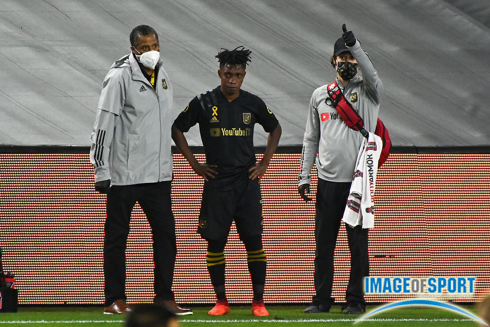 LAFC forward Latif Blessing (7) is assisted off the field by LAFC medical staff during a MLS soccer game, Sunday, Sept. 27, 2020, in Los Angeles. The San Jose Earthquakes defeated LAFC 2-1.(Dylan Stewart/Image of Sport)
