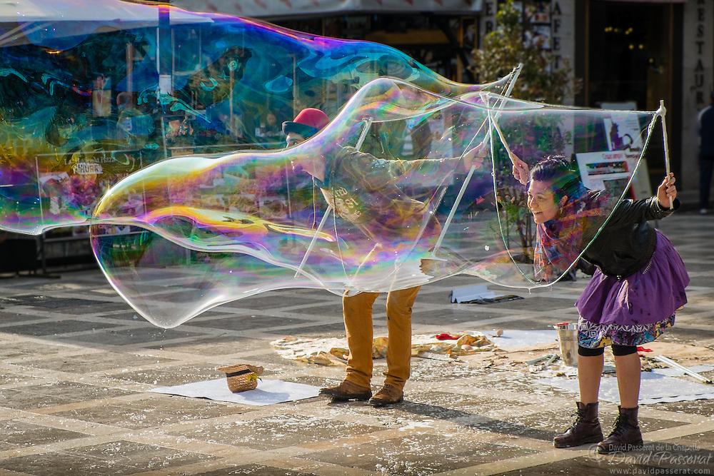 Big bubbles in the street of Granada.