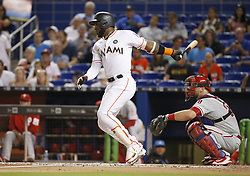 August 31, 2017 - Miami, FL, USA - Miami Marlins left fielder Marcell Ozuna hits a single during the second inning against the Philadelphia Phillies at Marlins Park in Miami on Thursday, Aug. 31, 2017. The Phillies won, 3-2. (Credit Image: © David Santiago/TNS via ZUMA Wire)