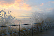 © Licensed to London News Pictures. 30/11/2013. Southwold, UK Crashing waves on the seafront in Southwold, Suffolk at sunrise today, 30 November 2013. Photo credit : Stephen Simpson/LNP