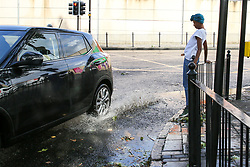 © Licensed to London News Pictures. 10/08/2019. London, UK. A car splashes water as it drives through a flood caused by a downpour on Green Lanes, Harringay in north London. Photo credit: Dinendra Haria/LNP