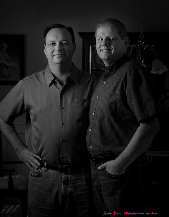 Campaign 2020 - voter profiles - Chip Deere, left, and his husband Ricky Phillips of Upper Nazareth Township, pose in their Upper Nazareth home Sunday, October 4, 2020.