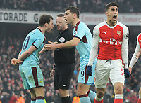 Football - 2016 / 2017 Premier League - Arsenal vs. Burnley<br /> <br /> Referee Jon Moss is shouted in his face by an angry Ashley Barnes of Burnley after awarding Arsenal with an injury time penalty whish they scored at The Emirates.<br /> Gabriel of Arsenal celebrates the decesion.<br /> <br /> COLORSPORT/ANDREW COWIE