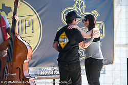 Marriage proposal on stage at the Giddy Up Vintage Chopper Show at the River Road Ice House, New Breunfils, TX March 28, 2015, photographed by Michael Lichter. ©2015 Michael Lichter