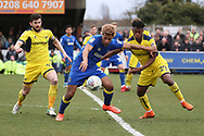 AFC Wimbledon striker Lyle Taylor (33) battles for possession with Oxford United defender Ashley Smith-Brown (29) during the EFL Sky Bet League 1 match between AFC Wimbledon and Oxford United at the Cherry Red Records Stadium, Kingston, England on 10 March 2018. Picture by Matthew Redman.