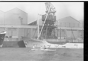 """08/03/1964<br /> 03/08/1964<br /> 08 March 1964<br /> Views at the port of Dublin. View of canoeing in Dublin Port, with the ship """"Vermeersingel""""."""