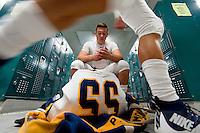Oak Ridge Trojan Parker Blomquist (55), gets ready in the locker room before the game as the Granite Bay Grizzlies host the Oak Ridge Trojans, Friday, October 9, 2015.<br /> Photo Brian Baer