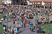 PERU, HIGHLANDS, CUZCO the Plaza de Armas and crowds