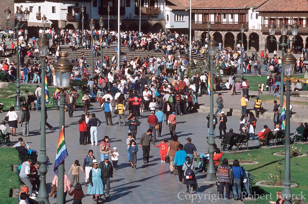 PERU, HIGHLANDS, CUZCO the Plaza de Armas and crowds