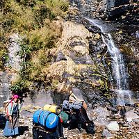 "A mason carves Tibetan Buddhist prayers into a ""mani"" rock in the Khumbu region of Nepal 1986."