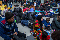ATHENS, GREECE - FEBRUARY 05: More than 300 refugees take shelter in a ward at the Pireaus port after arriving by ferry from the Greek Islands on February 05, 2015 in Athens, Greece. Hundreds of refugees are stranded at the Pireaus port as authorities pushes refugees at the islands to board ferries one day before a General Strike called in Greece. Photo: © Omar Havana. All Rights Are Reserved
