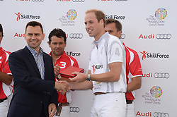 MARTIN SANDER presents a prize to HRH THE DUKE OF CAMBRIDGE at the Audi Polo Challenge 2013 at Coworth Park Polo Club, Berkshire on 3rd August 2013.