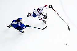 Iceland's Silvia Bjorgvinsdottir (right) and Slovenia's Sara Confidenti battle for the puck during the Beijing 2022 Olympics Women's Pre-Qualification Round Two Group F match at the Motorpoint Arena, Nottingham.