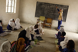 Students are seen during class at the school created by Mukhtar Mai, Meerwala, Pakistan, April 29, 2005. Mai, 33, went against the Pakistani tradition of committing suicide when she brought charges against the men who gang raped her nearly three years ago. With money from the ruling she opened two schools, one for girls, the other for boys, citing that education is the only thing that will stop such acts from happening.
