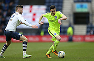 Brighton winger, Jamie Murphy (15) gets away from Preston North End Defender Marnick Vermijl (2) during the Sky Bet Championship match between Preston North End and Brighton and Hove Albion at Deepdale, Preston, England on 5 March 2016.