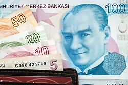 April 25, 2018 - Ankara, Turkey - The 100 Turkish Lira banknote (TRY) next to a wallet with denominations of 5, 10, 20 and 50 lira bills. Photo taken 25 April 2018. (Credit Image: © Diego Cupolo/NurPhoto via ZUMA Press)