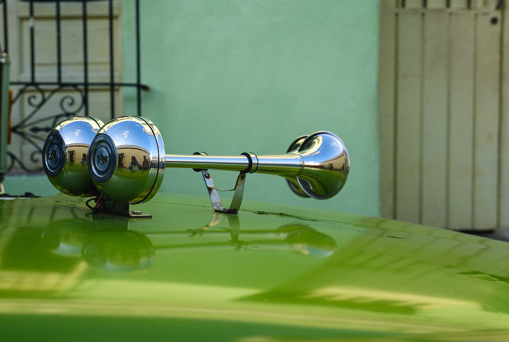 CAMAGUEY, CUBA - CIRCA JANUARY 2020: Detail of car horn in the streets of Camaguey