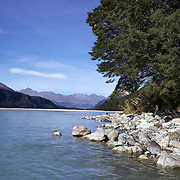 Autumn on Dart River's braided river system in Mount Aspiring National Park. near Glenorchy..Glenorchy is a small settlement nestled in spectacular scenery at the northern end of Lake Wakatipu in New Zealand's south Island. It is approximately 45 kilometres by road or boat from Queenstown, the nearest large town..Glenorchy is a popular tourist spot, close to many tramping tracks. It lies near the borders of Mount Aspiring National Park and Fiordland National Park. The local scenery received worldwide attention when it was used as one of the settings in the first of Peter Jackson's Lord of the Rings films. Glenorchy is the home of  Dart River Jet Safaris. The  unique adventure combines exhilarating wilderness jet boating with unique Funyak inflatable canoes used to explore the magnificent World Heritage wilderness within Mt Aspiring National Park. Professional guides take participants through dramatic landscapes, paddling along channels of the glacier fed Dart River's braided river system as well as along hidden side streams, rock pools and dramatic chasms. Glenorchy, New Zealand. 13th April 2011. Photo Tim Clayton..