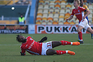 Tariqe Fosu-Henry of Charlton Athletic (11) is flattened during the The FA Cup match between Mansfield Town and Charlton Athletic at the One Call Stadium, Mansfield, England on 11 November 2018.