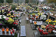 Lodz, Poland cemetery in the rain on All Saints Day.