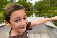 Young boy enjoys a boat ride in the Florida Everglades