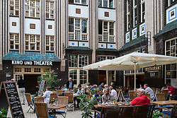 Busy cafe in courtyard at historic Hackescher Markt in Mitte Berlin Germany