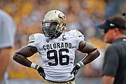SHOT 9/1/13 4:30:33 PM - Colorado's Chidera Uzo-Diribe #96 during a break in the action while playing against Colorado State during the 2013 Rocky Mountain Showdown at Sports Authority Field at MiIe HIgh Stadium in Denver, Co. Colorado won the annual in-state rivalry 41-27. (Photo by Marc Piscotty / © 2013)