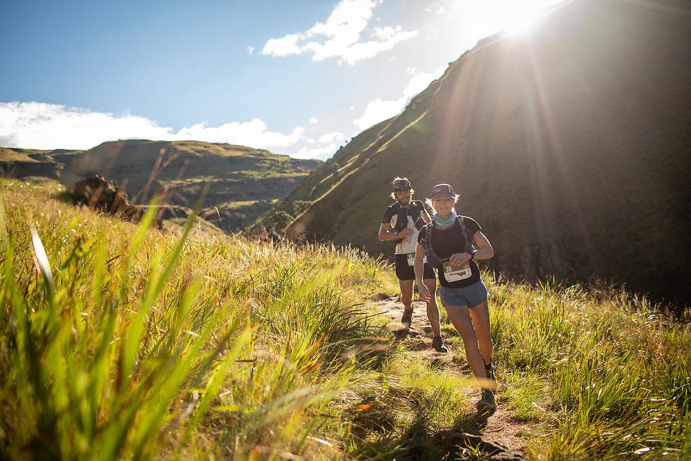 Jo Keppler runs with Armand Du Plessis during the 2021 Ultra Trail Drakensberg. © Nick Muzik