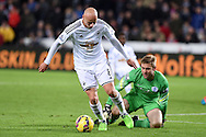 Jonjo Shelvey of Swansea city (l) tries to go past QPR goalkeeper Robert Green.Barclays Premier league match, Swansea city v Queens Park Rangers at the Liberty stadium in Swansea, South Wales on Tuesday 2nd December 2014<br /> pic by Andrew Orchard, Andrew Orchard sports photography.