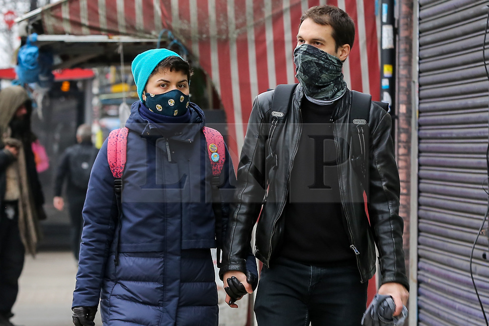 © Licensed to London News Pictures. 02/03/2021. London, UK. A couple wearing protective face coverings in north London. The number of Covid-19 infection rate and deaths have dropped more than a quarter within a week as the effect of lockdown restrictions and vaccine rollout is making an impact. Six cases of the P1 variant have been identified in people who recently returned from Brazil. Photo credit: Dinendra Haria/LNP
