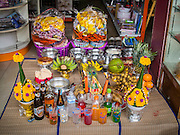 """10 AUGUST 2014 - BANGKOK, THAILAND: Food left out for ghosts on the first day of Ghost Month in Bangkok. The seventh month of the Chinese Lunar calendar is called """"Ghost Month"""" during which ghosts and spirits, including those of the deceased ancestors, come out from the lower realm. It is common for Chinese people to make merit during the month by burning """"hell money"""" and presenting food to the ghosts.    PHOTO BY JACK KURTZ"""