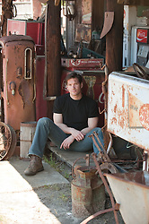 Man seated outside a junk store in South Carolina