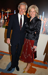 LADY ANNUNCIATA ASQUITH and the EARL OF LICHFIELD at the Harpers & Queen and Moet & Chandon Restaurant Awards for 2004 held at Claridges, Brook Street, London on 1st November 2004.<br />