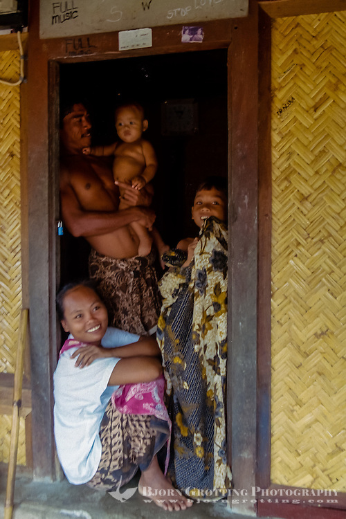Nusa Tenggara, Lombok, Sade. Sade village. A Sasak family in a traditional Sasak house.