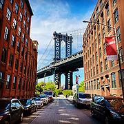 Photograph of the Manhattan Bridge in New York City from the heart of DUMBO or Down Under the Manhattan Bridge Underpass in Brooklyn