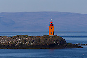 Flatey Lighthouse, located on the small island of Klofningur about a half-mile from Flatey's Harbor, helps to guide vessels on the waters of Breidafjörður, Iceland. The Flatey Lighthouse was built in 1926.