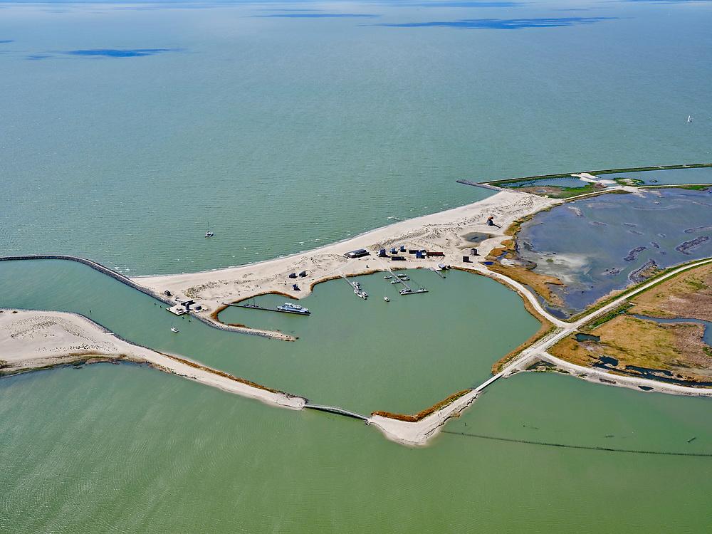 Nederland, Flevoland, Markermeer, 07-05-2021; Marker Wadden in het Markermeer. Haven.<br /> Doel van het project van Natuurmonumenten en Rijkswaterstaat is natuurherstel, met name verbetering van de ecologie in het gebied, in het bijzonder de kwaliteit van bodem en water. De Marker Wadden archipel bestaat momenteel uit vijf eilanden, twee nieuwe eilanden zijn in ontwikkeling.<br /> Marker Wadden, artifial islands. The aim of the project is to restore the ecology in the area, in particular the quality of soil and water.<br /> The Marker Wadden archipelago currently consists of five islands, two new islands are under development.<br /> luchtfoto (toeslag op standard tarieven);<br /> aerial photo (additional fee required)<br /> copyright © 2021 foto/photo Siebe Swart
