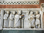 Late medieval relief sculpture of St Martin expelling an evil demon from a robber on the Facade of the Cattedrale di San Martino,  Duomo of Lucca, Tunscany, Italy, .<br /> <br /> Visit our ITALY HISTORIC PLACES PHOTO COLLECTION for more   photos of Italy to download or buy as prints https://funkystock.photoshelter.com/gallery-collection/2b-Pictures-Images-of-Italy-Photos-of-Italian-Historic-Landmark-Sites/C0000qxA2zGFjd_k<br /> <br /> <br /> Visit our MEDIEVAL PHOTO COLLECTIONS for more   photos  to download or buy as prints https://funkystock.photoshelter.com/gallery-collection/Medieval-Middle-Ages-Historic-Places-Arcaeological-Sites-Pictures-Images-of/C0000B5ZA54_WD0s .<br /> <br /> If you prefer to buy from our ALAMY PHOTO LIBRARY  Collection visit : https://www.alamy.com/portfolio/paul-williams-funkystock/lucca.html .