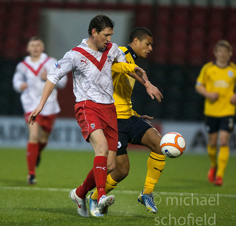 Airdrie United's David Lilley and Falkirk's Lyle Taylor..half time : Airdrie United 1 v 4 Falkirk, 22/12/2012..©Michael Schofield.