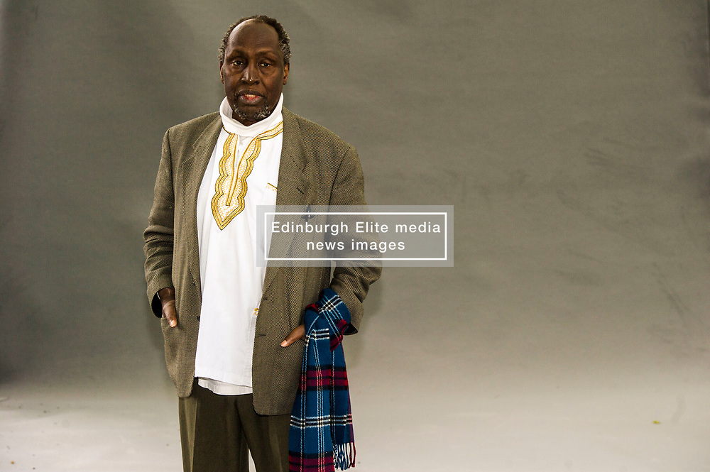 """Pictured: Ngũgĩ wa Thiong'o<br /> <br /> Ngũgĩ wa Thiong'o (Gikuyu pronunciation: [ᵑɡoɣe wá ðiɔŋɔ]; born 5 January 1938)[1] is a Kenyan writer, formerly working in English and now working in Gikuyu. His work includes novels, plays, short stories, and essays, ranging from literary and social criticism to children's literature. He is the founder and editor of the Gikuyu-language journal Mũtĩiri.<br /> <br /> In 1977, Ngũgĩ embarked upon a novel form of theatre in his native Kenya that sought to liberate the theatrical process from what he held to be """"the general bourgeois education system"""", by encouraging spontaneity and audience participation in the performances.[2] His project sought to """"demystify"""" the theatrical process, and to avoid the """"process of alienation [that] produces a gallery of active stars and an undifferentiated mass of grateful admirers"""" which, according to Ngũgĩ, encourages passivity in """"ordinary people"""". Although Ngaahika Ndeenda was a commercial success, it was shut down by the authoritarian Kenyan regime six weeks after its opening.<br /> <br /> Ngũgĩ was subsequently imprisoned for over a year. Adopted as an Amnesty International prisoner of conscience, the artist was released from prison, and fled Kenya. In the United States, he taught at Yale University for some years, and has since also taught at New York University, with a dual professorship in Comparative Literature and Performance Studies, and at the University of California, Irvine. Ngũgĩ has frequently been regarded as a likely candidate for the Nobel Prize in Literature. His son is the author Mũkoma wa Ngũgĩ.<br /> <br /> Ger Harley 