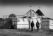 'A roof held up with prayers and duct tape,' St Michael's Church, (Ethiopian and Eritrean Orthodox) The Jungle. Migrant Camp, Calais, France.<br /> April 2016
