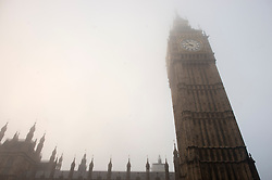 © Licensed to London News Pictures.11/12/2013. London, UK.A general view of the Palace of Westminster in fog this morning.Photo credit : Peter Kollanyi/LNP