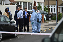 © Licensed to London News Pictures. 04/06/2020.  London UK:  Police and Forensic officers investigate a shooting in Wilmington Gardens in Barking, East London. A male in his twenties was rushed to hospital where his condition is life threatening , Photo credit: Steve Poston/LNP
